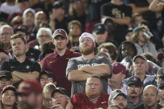 Fans cheer on their team from the stands as the Seminoles take on the Hokies of Virginia Tech at Doak Campbell Stadium on Monday, Sept. 3, 2018.