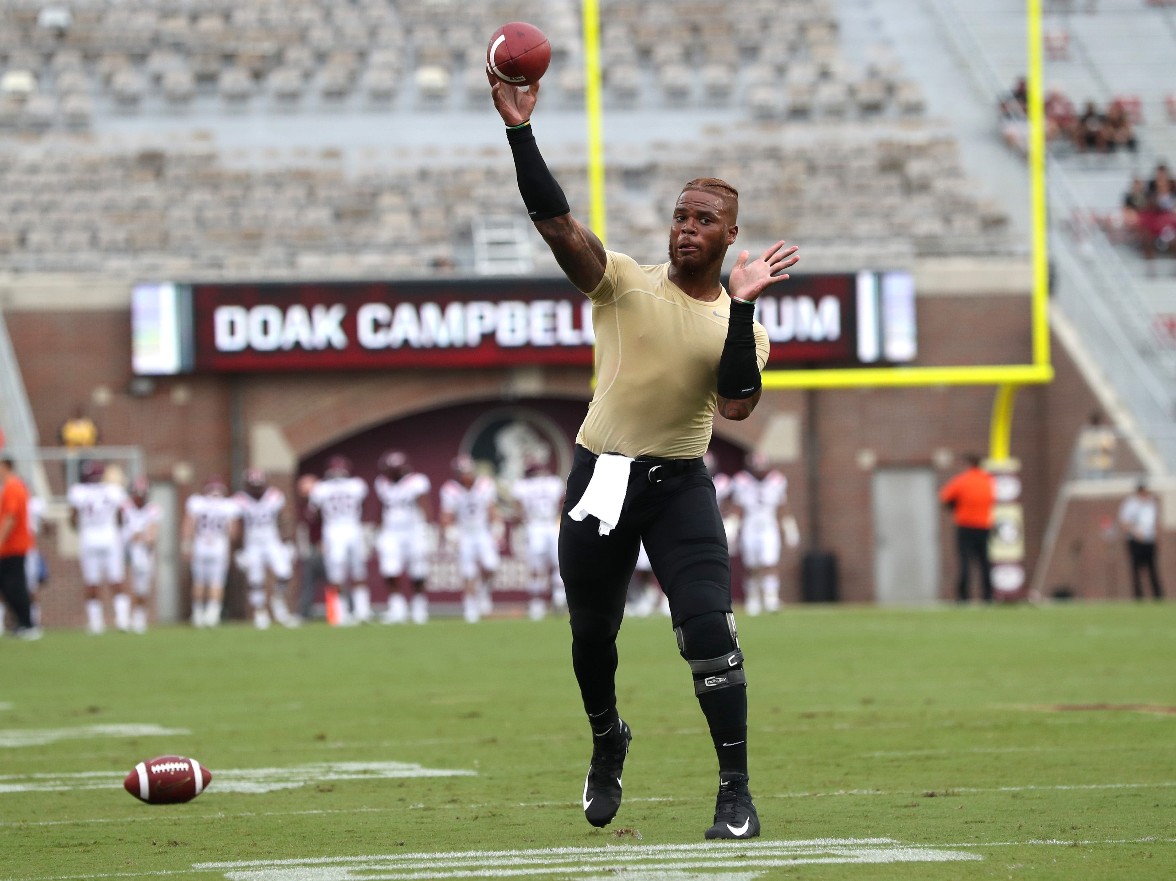 FSU's Deondre Francois warms up before their game against Virginia Tech to open the season at Doak Campbell Stadium in Tallahassee, Fla. On Monday Sept. 3, 2018.