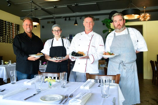 The kitchen staff of Mimi's Table. From left to right: Meeting and Events Planner Shawn Moye, Chef Abby Henderson, Chef William Lawson, and Chef Allen Tenton.