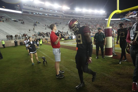FSU's Brain Burns walks off the field dejected after their 24-3 loss against Virginia Tech at Doak Campbell Stadium in Tallahassee, Fla. on Monday, Sept. 3, 2018.