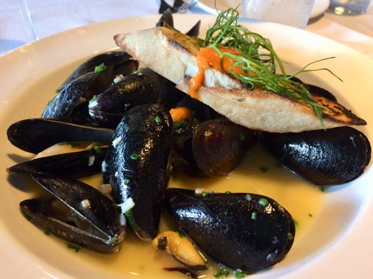 Mussels are bathed in a broth spiked with sherry at Mimi's Table.