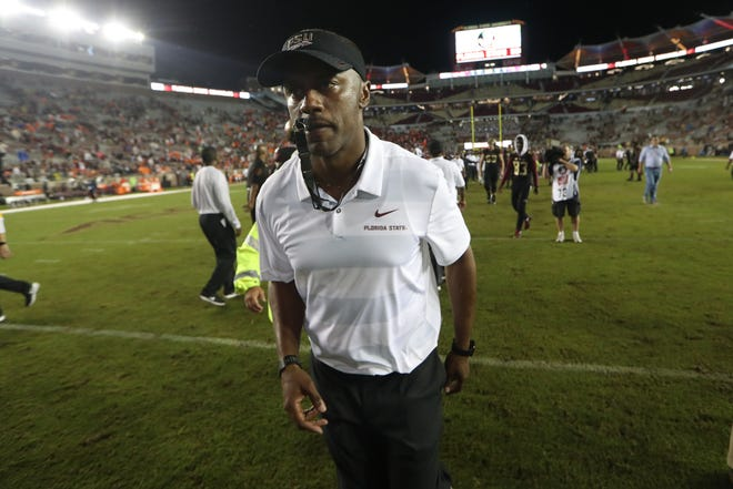 FSU Head Coach Willie Taggart walks off the field after their 24-3 loss against Virginia Tech at Doak Campbell Stadium in Tallahassee, Fla. on Monday, Sept. 3, 2018.