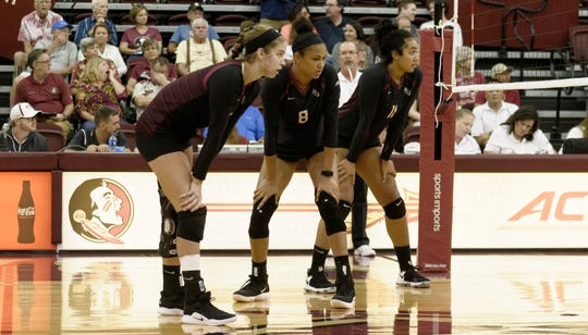 From left to right: Adrian Ell (redshirt freshman setter), Tiana Jackson (sophomore middle blocker) and Ashley Murray (redshirt senior middle blocker) get set for action in Florida State's preseason scrimmage against South Alabama.