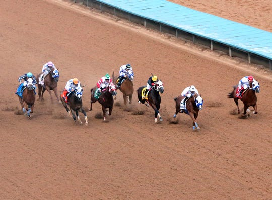 Apocalyptical Jess, second from right, with jockey Raul Ramirez, Jr. overtakes Im Jess Special V, 4, with jockey Agustin Silva and Tools in the Sky, right, with jockey Felipe Garcia-Luna to win the 60th All American Futurity Monday at Ruidoso Downs Racetrack and Casino.