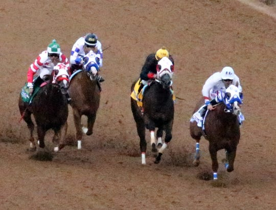 Apocalyptical Jess, right, with jockey Raul Ramirez Jr. aboard, wins the All American Futurity on Monday at Ruidoso Downs Racetrack and Casino.