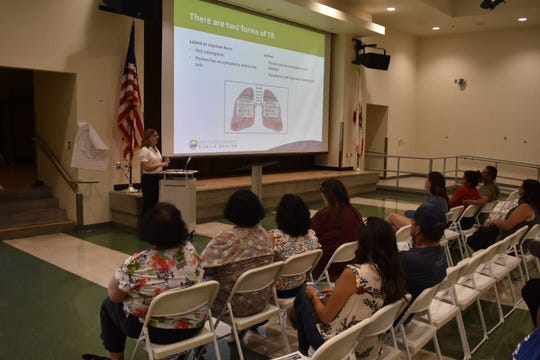 Dr. Uldine Castel of the Ventura County Public Health Department talks to parents at Rio Vista Middle School in Oxnard about tuberculosis.