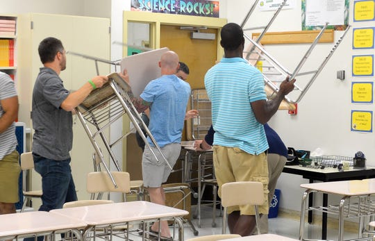 """Millville public schools staff barricade a classroom door during """"active shooter"""" training at Lakeside Middle School on Tuesday, September 4."""