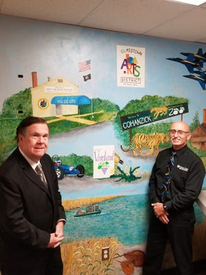 Cumberland County Freeholders Jim Quinn (left) and Joe Derella show off a mural in the Cumberland County Administration Building, which was recently completed by artist Maryann Cannon.