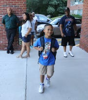 Derrick Jenkins Jr., make his way during the first day of school at the Highview School in Hartsdale, Sept. 4, 2018.