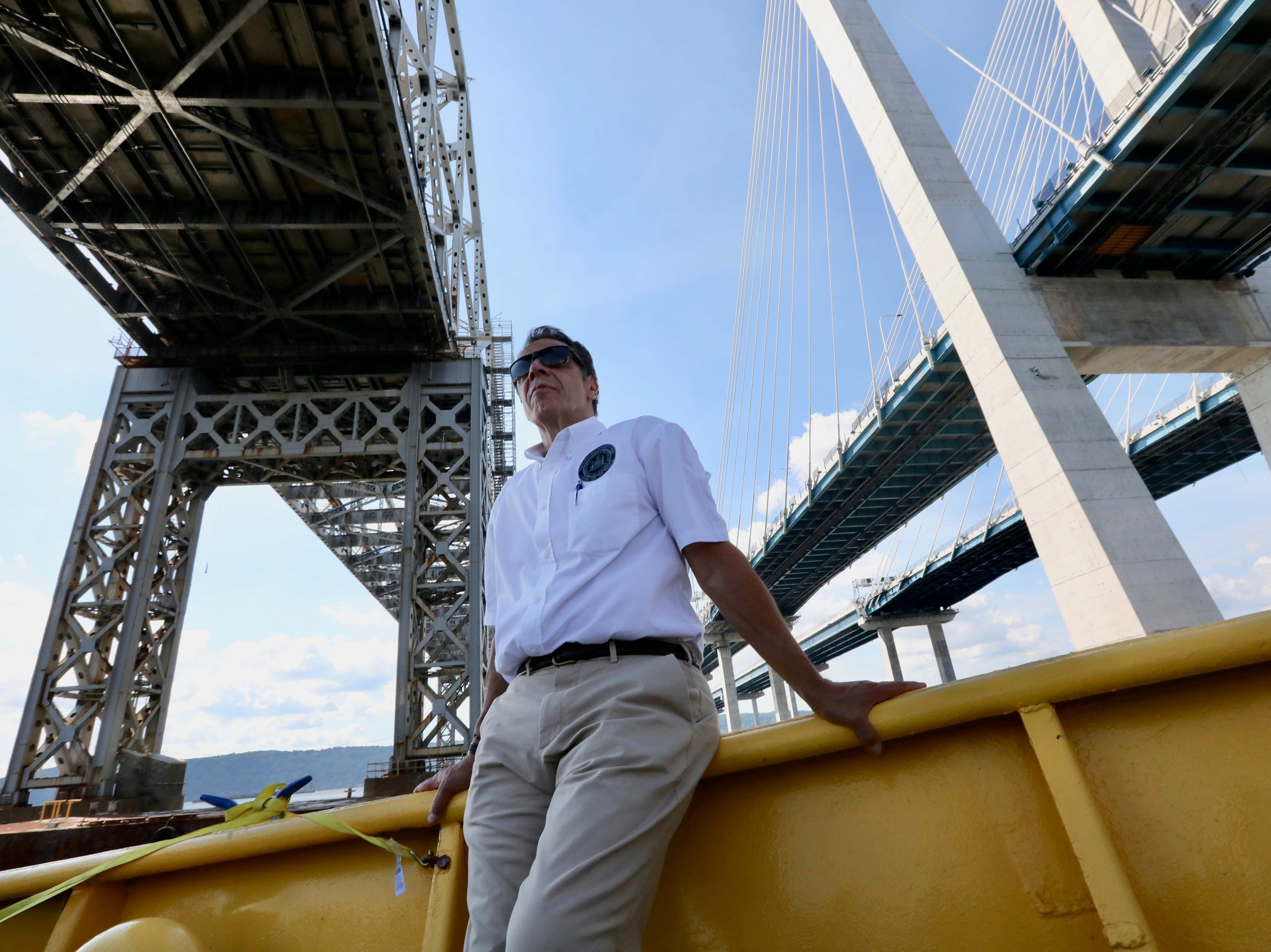 Gov. Andrew Cuomo with the Tappan Zee and Gov. Mario M. Cuomo Bridges during a boat tour Tuesday, Sept. 4, 2018. He announced that the second Cuomo Bridge span would open to traffic Saturday, Sept. 8, 2018.