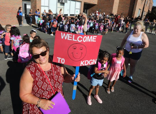West Haverstraw Elementary kindergarten teacher Mariann Albin welcomes students on the first day of full day  kindergarten Sept. 4, 2018.