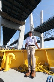 Gov. Andrew Cuomo on a boat under the Gov. Mario Cuomo Bridge, which he named after his father. The governor has positioned himself as the rallying point for opposition to President Donald Trump in the state.
