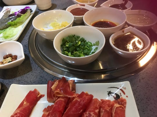 H-Yan Hot Pot & BBQ in the Newark Shopping Center features interactive cooking.
