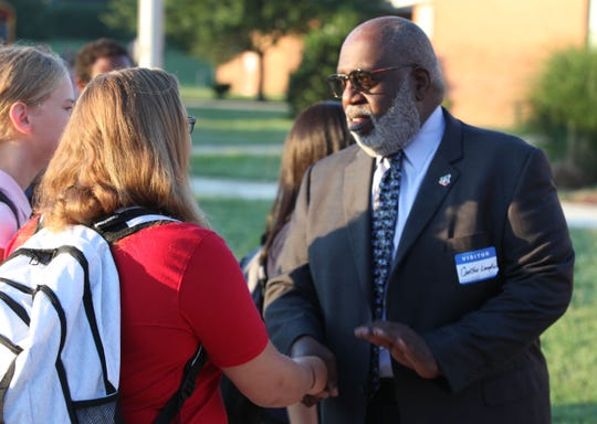 Carlton Lampkins, chair of Communities in Schools Delaware, on Tuesday greets students as they arrive at McKean High School. The event was part of Suit Up, Show Up, of which four Delaware schools were a part of this year.