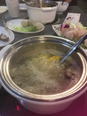 At H-Yan Hot Pot & BBQ in Newark, diners cook their own food.
