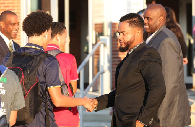 Tramaine Smith, founder of Born4Brothas, on Tuesday, helps greet students morning to McKean High School.