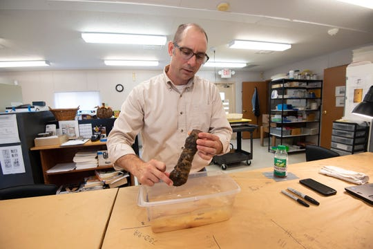 Paul Nasca, Delaware state curator of archeology, inside the archeology lab at Cape Henlopen State Park in Lewes, with items from the Roosevelt Inlet shipwreck collection.