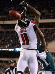 Atlanta wide receiver Julio Jones can't hold the potential game-winning touchdown pass last January against the Eagles in the Eagles' 15-10 win. Jalen Mills provides the coverage.