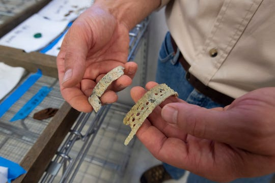 Shoe buckles from the Roosevelt Inlet shipwreck collection at the archeology lab at Cape Henlopen State Park are being moved to the state's archaeological curation facility in Dover.