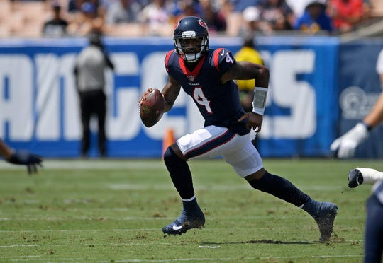 Houston Texans quarterback Deshaun Watson tore his ACL last season, just like Eagles quarterback Carson Wentz.
