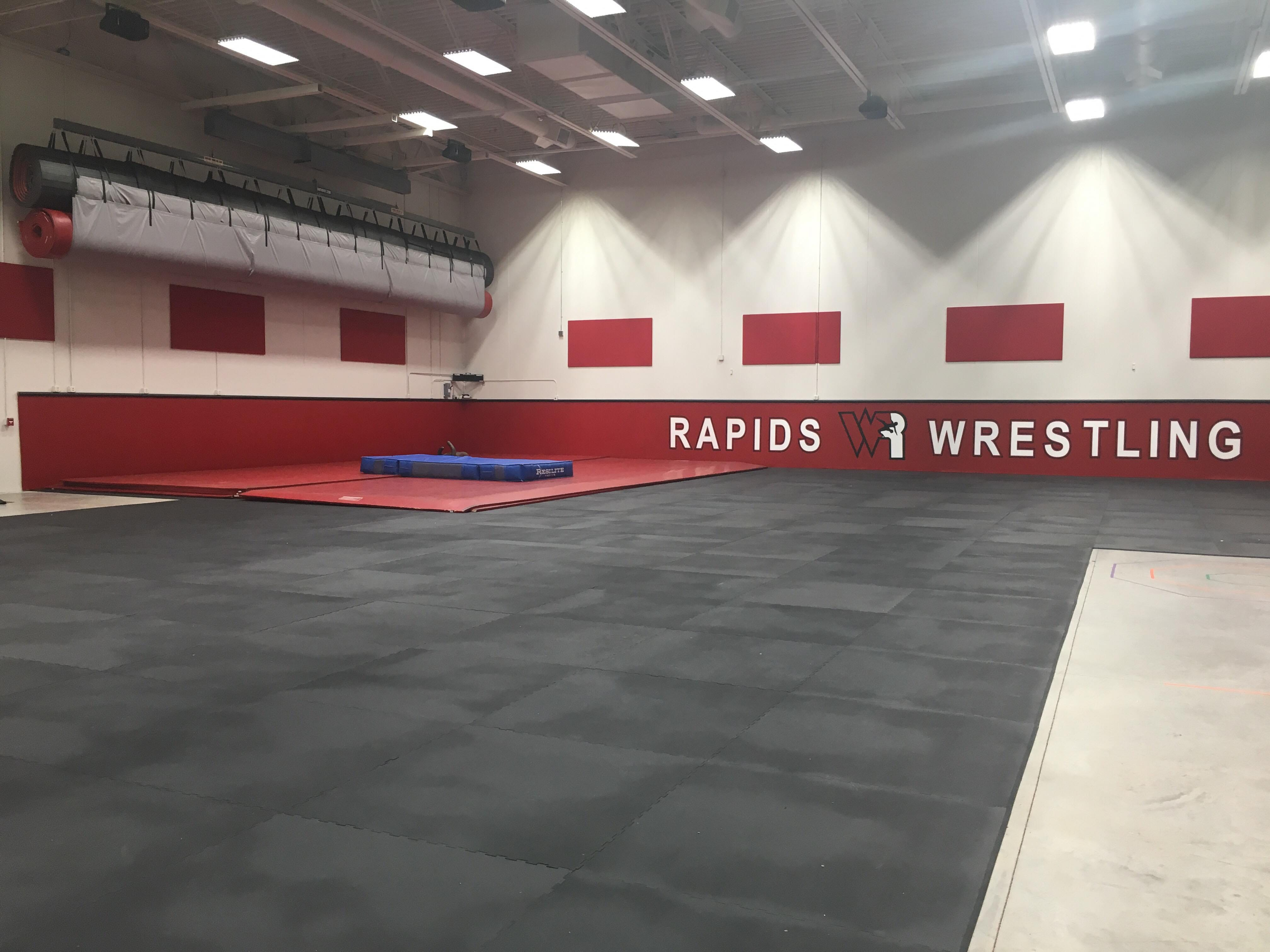 The wrestling portion of Lincoln High School's new auxiliary gym. Wrestlers will share the gym with the gymnastics team.