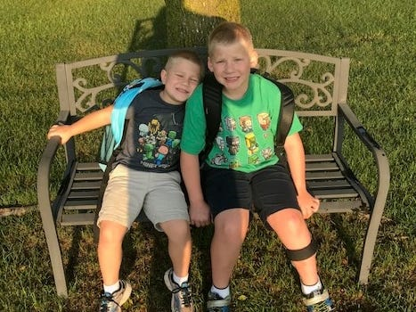 Luke Flowerette on his first day of kindergarten and Landon Flowerette on his first day of third grade at St. Stephens School in Stevens Point.