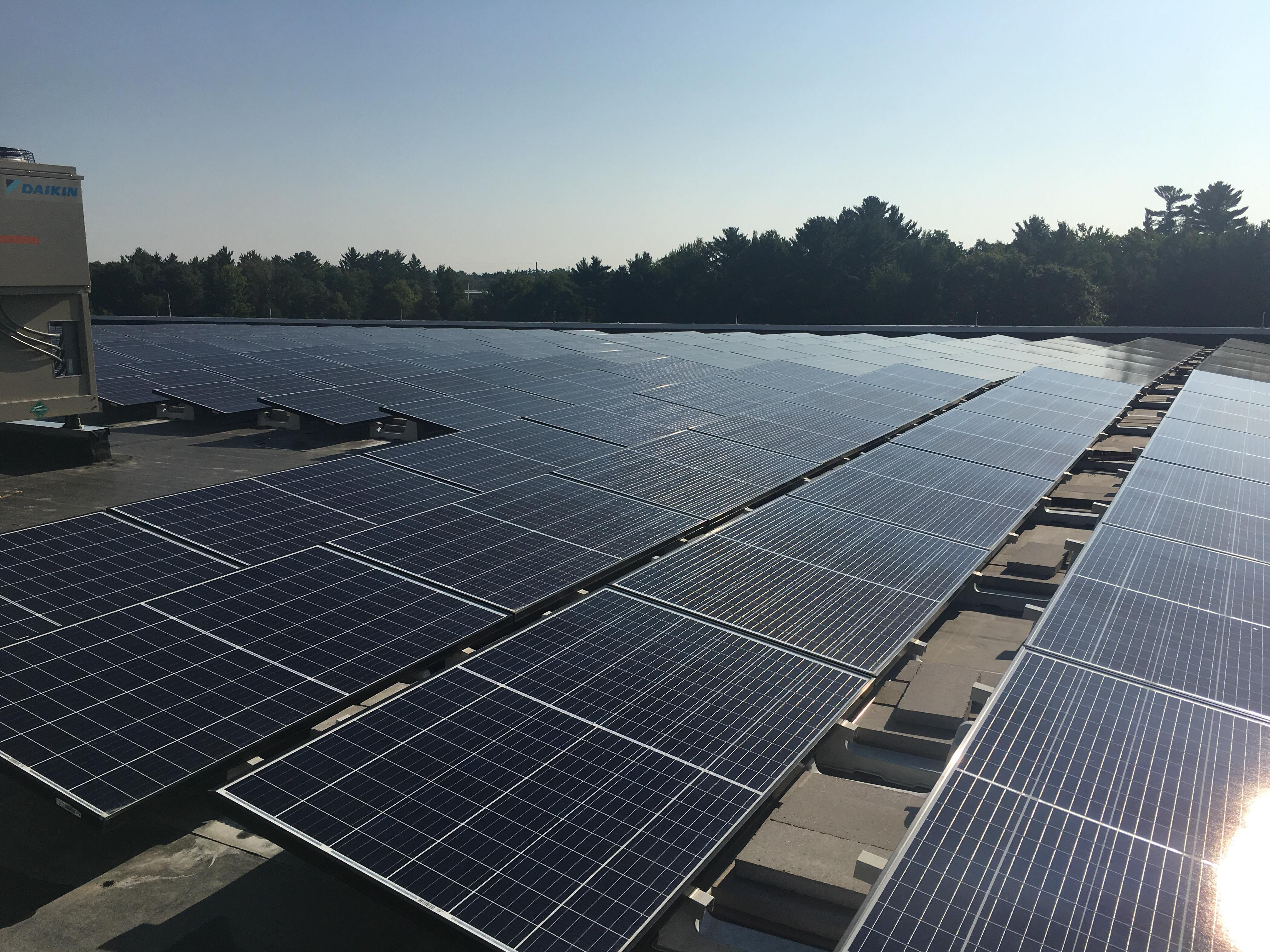 Solar panels on Lincoln High School's roof soak up the sun Friday, August 24, 2018.