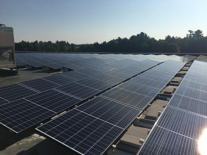 Solar panels on Lincoln High School's roof soak up the sun Friday, Aug. 24, 2018.
