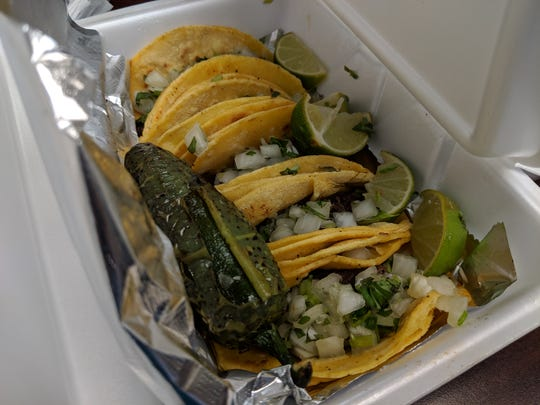 Barbacoa tacos on corn torillas