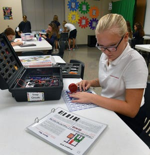 In this file photo, Christ Academy student Aubrey Lohman designs a sound effects generator while working with electronic circuitry in the school's STEAM Lab. The private school announced they will open for in-person classes Aug. 13.