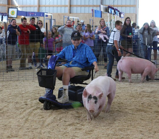 Cody Otto, 15, leads his pig, Wilbur around the ring in an exhibition class at the Manitowoc County Fair on Aug. 22. An online auction for the pig raised $1,250, which was donated to Miracle League of Lakeshore.