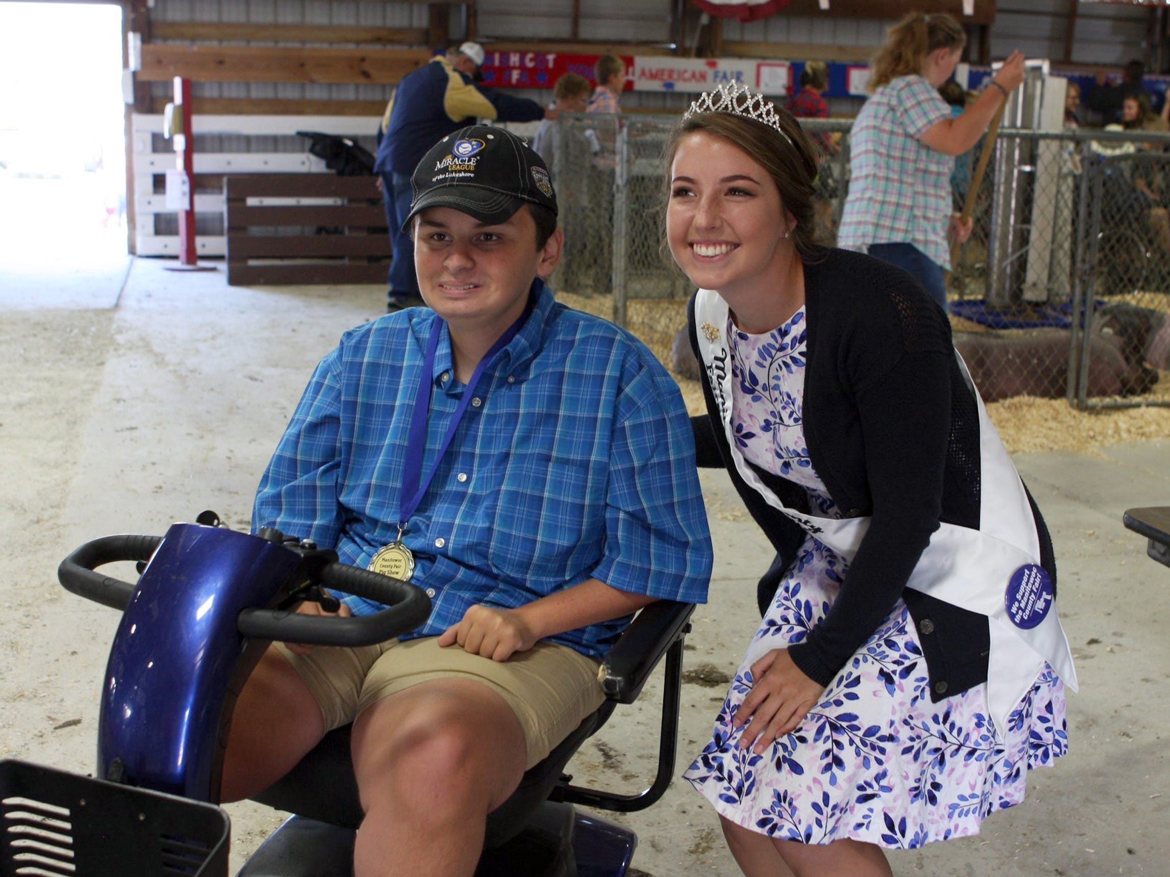 Cody Otto, 15, poses with Manitowoc County's Fairest of the Fair, Emily Hutterer, after showing his pig, Wilbur in an exhibition class at the fair.