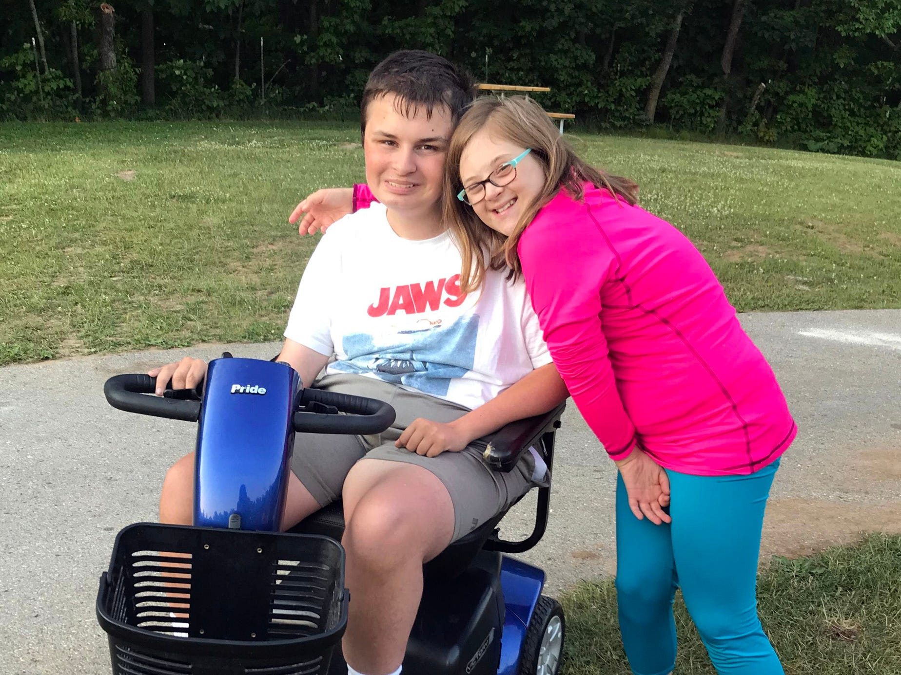 Cody Otto is pictured with his friend Ann Marie. Both showed pigs at the Manitowoc County Fair and donated funds from the auction to Miracle League of the Lakeshore.
