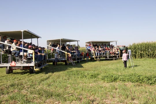 Three mobile bleachers held a capacity crowd as UW–Madison/UW-Extension soil scientist Carrie Laboski elaborates on a down-to-earth study on fertilizer management.