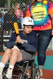 Cody Otto, 15, has played baseball for the past three years with Miracle League of the Lakeshore. Cody decided to donate money raised from the sale of his pig, Wilbur, to Miracle League.