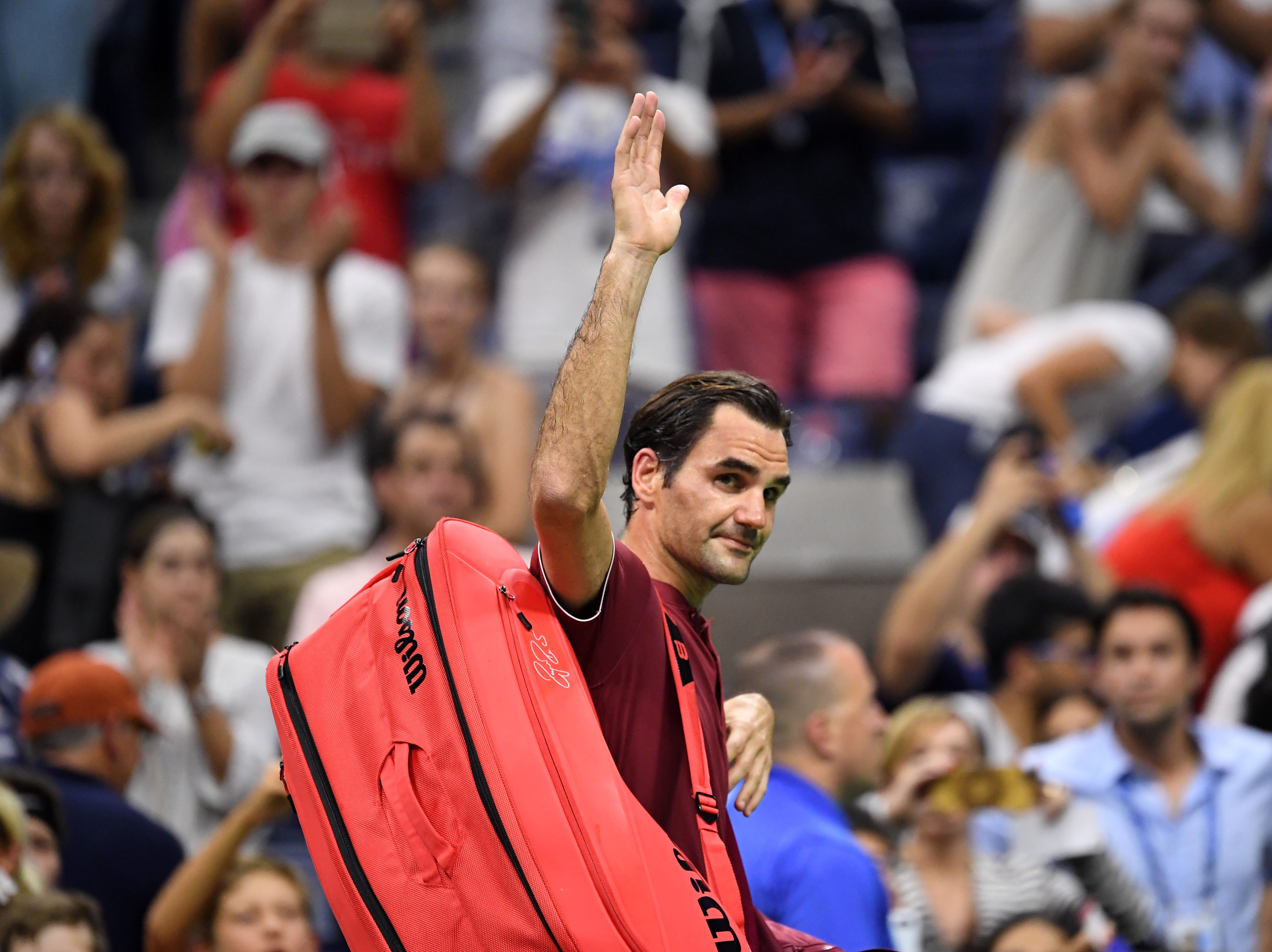 Roger Federer walks off the court after his loss to John Millman in the fourth round.