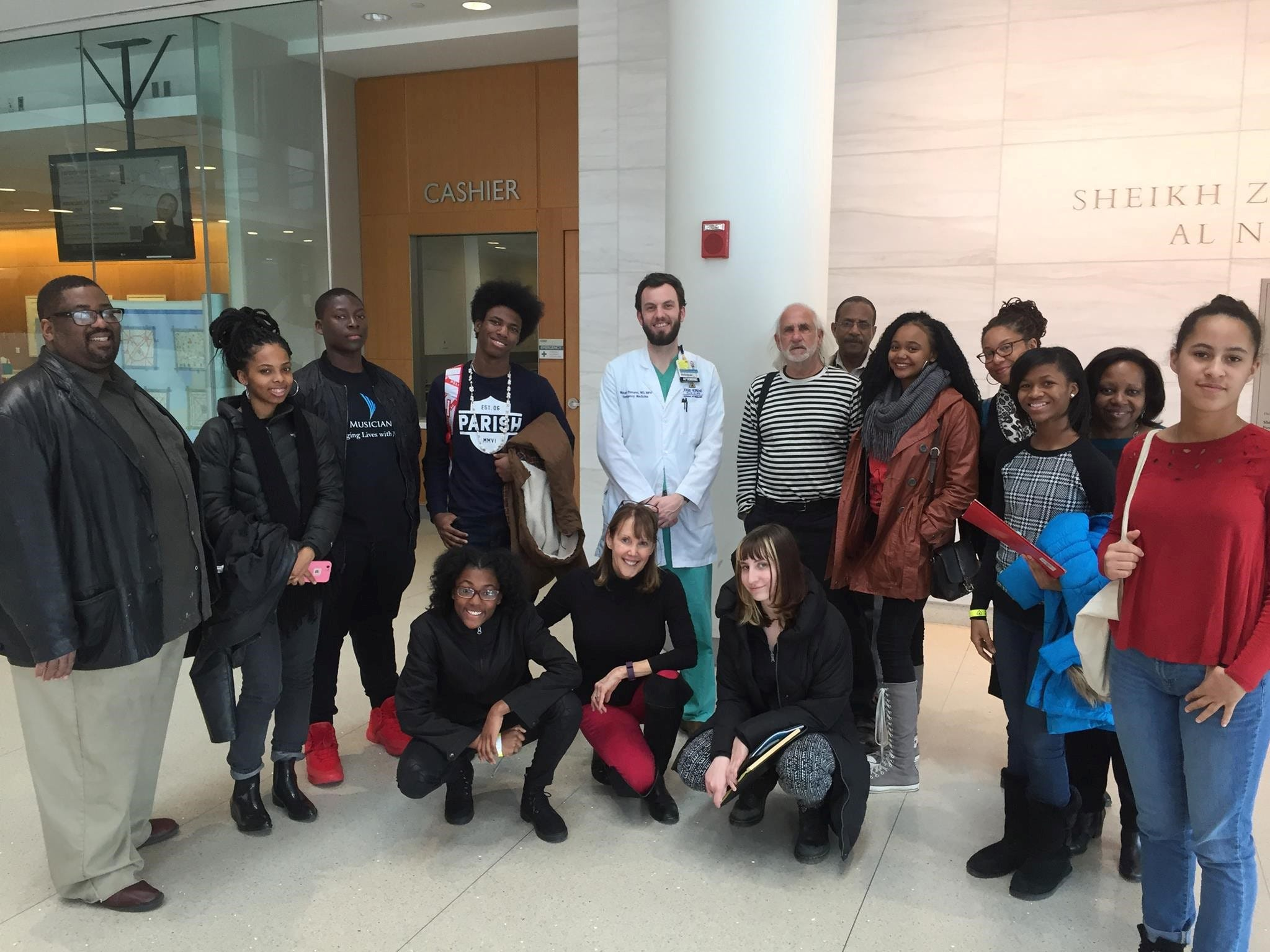 Washington and Baltimore high school students from the Urban Health Media Project - which USA TODAY's Jayne O'Donnell co-founded - are shown during a visit to discuss violence and trauma at Johns Hopkins University's hospital in March 2017.  Reggie Payne, who is to the right of physician Michael Ehmann (in lab coat), now insists group members maintain a close connection by sharing details of their previous week.
