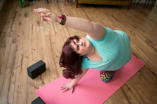 Estapa honing her craft at More to Love yoga studio.