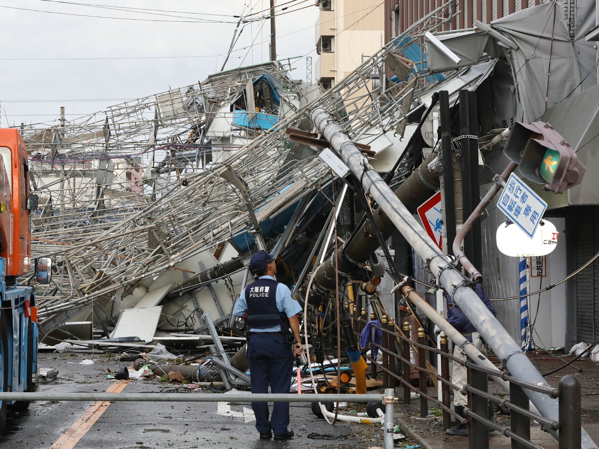 Damaged traffic boards and telecommunication relay poles are seen after they were brought down by strong winds caused by typhoon Jebi in Osaka on September 4, 2018. - The strongest typhoon to hit Japan in 25 years made landfall on September 4, the country's weather agency said, bringing violent winds and heavy rainfall that prompted evacuation warnings. (Photo by JIJI PRESS / JIJI PRESS / AFP) / Japan OUTJIJI PRESS/AFP/Getty Images ORIG FILE ID: AFP_18U3QP