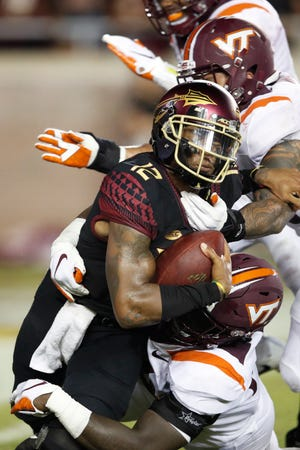 Florida State's Deondre Francois gets sacked by Virginia Tech's Trevon Hill in the second quarter of the game at Doak Campbell Stadium.