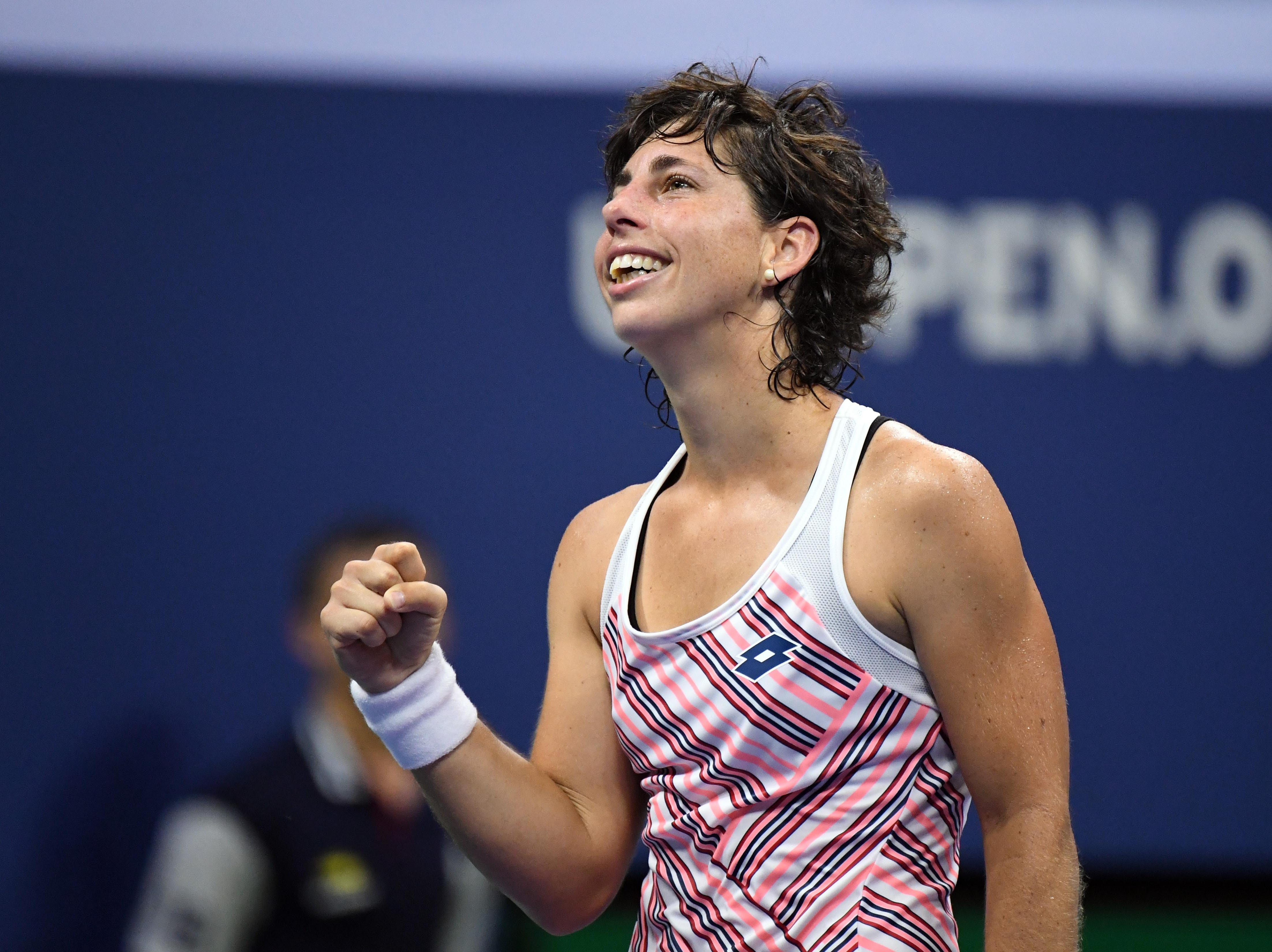 Carla Suarez Navarro celebrates match point against Maria Sharapova.