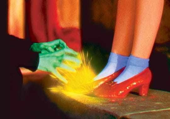 The Wicked Witch tries to take Dorothy's (Judy Garland's) ruby slippers in this scene from