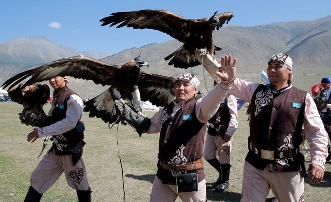 A Kazakh berkutchis (eagle hunter) holds an eagle during the third World Nomad Games in Cholpon-Ata, Kyrgyzstan, Sept. 4, 2018. Teams from 66 countries are competing in the ethnic sport games during the cultural event that runs through Sept. 8. The mission of the Games is to promote the revival and preservation of the historical heritage of nomadic people.