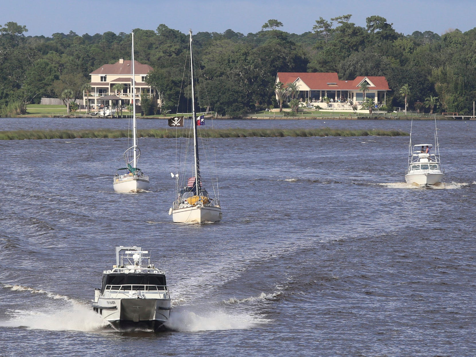 Boats make their way across Biloxi Back Bay in Biloxi, Miss.,as they evacuate to safe harbor, Sept. 3, 2018. Tropical Storm Gordon is expected to make landfall in Mississippi on Tuesday, possibly as a Category 1 hurricane. (John Fitzhugh/The Sun Herald via AP) ORG XMIT: MSGUL121