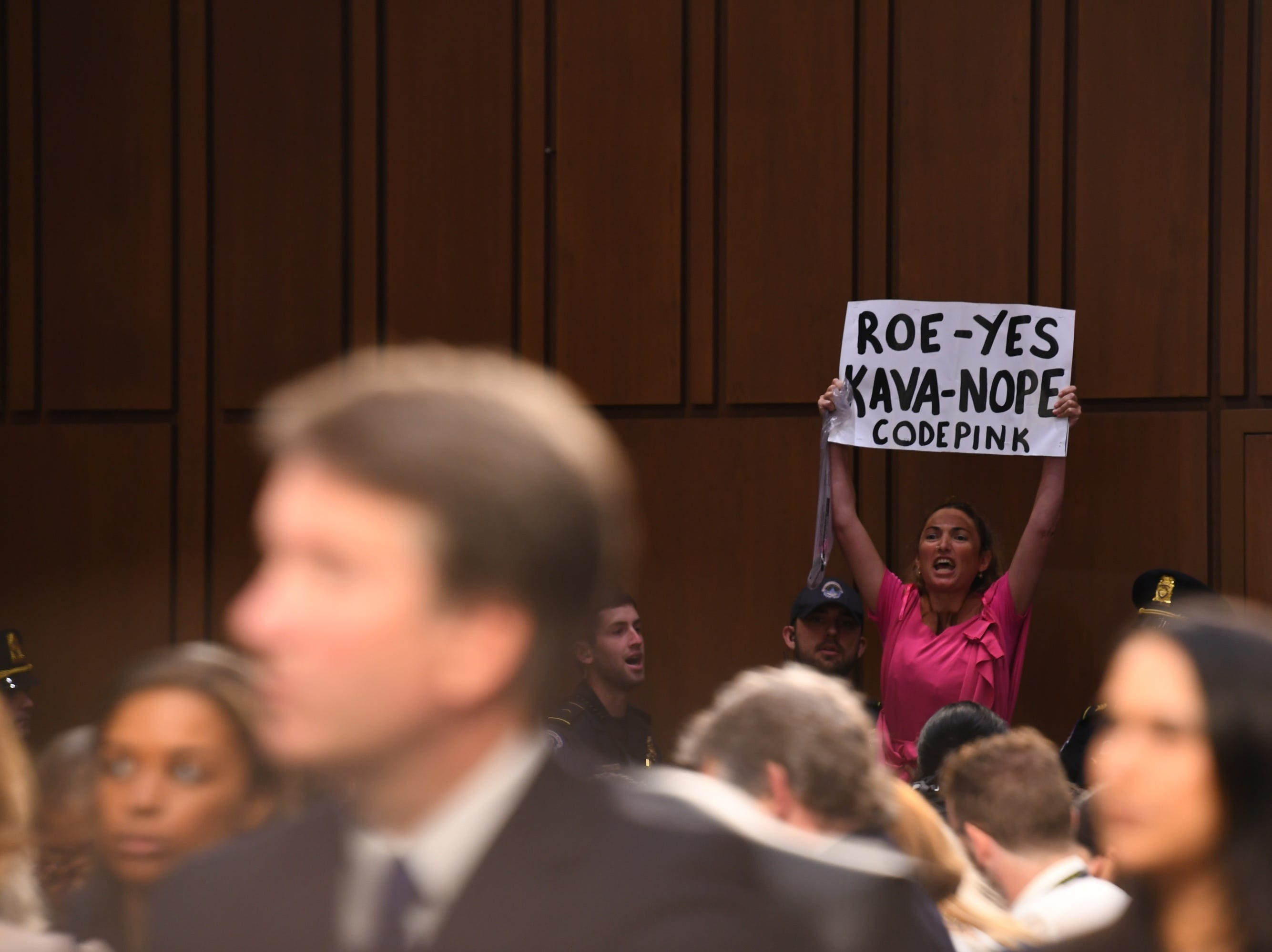 A protester interrupts the hearing for Supreme Court Associate Justice nominee Brett Kavanaugh on Sept. 4, 2018 in Washington.
