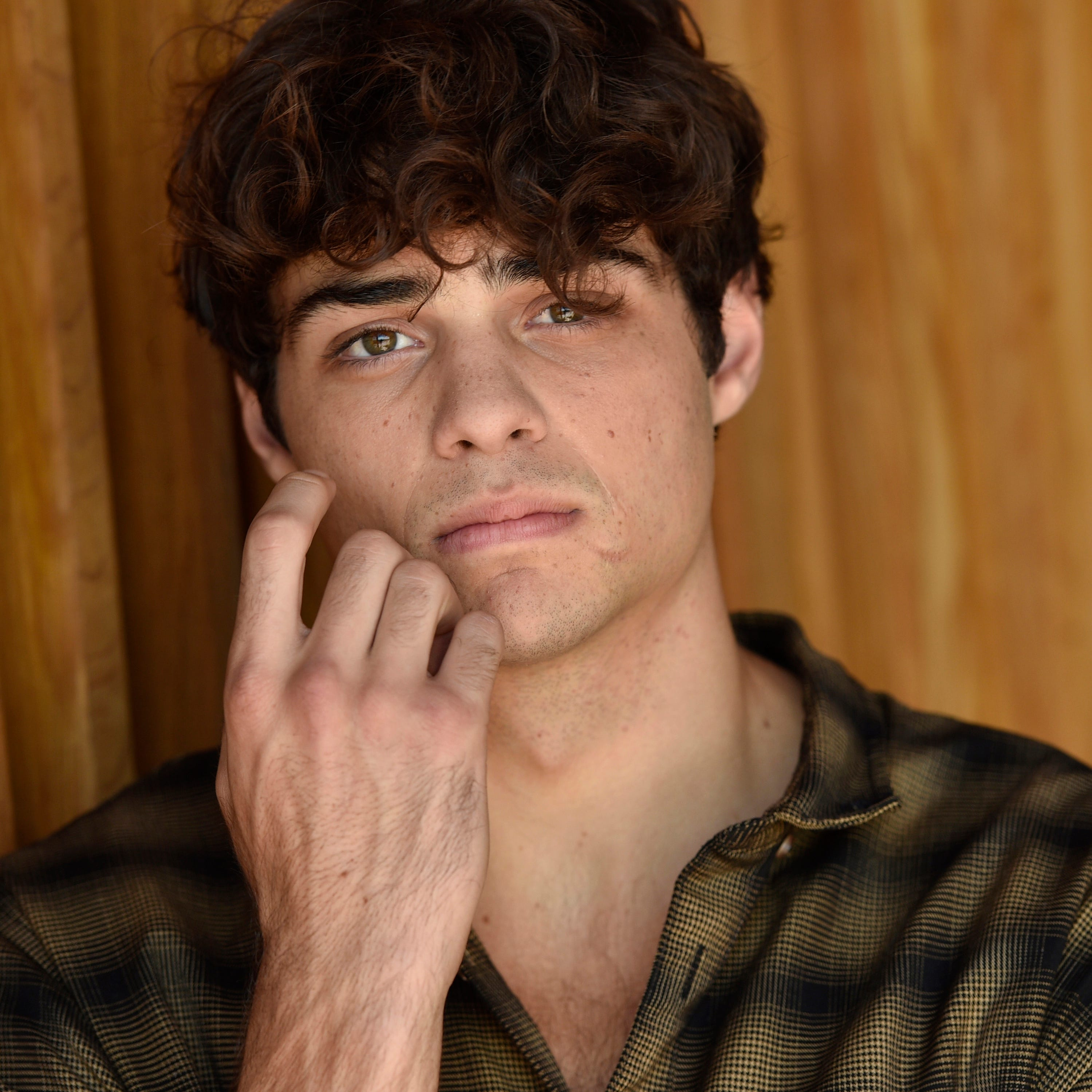 "In this Aug. 30, 2018 photo, Noah Centineo poses for a portrait to promote his Netflix film, ""To All the Boys I've Loved Before,"" in Los Angeles. (Photo by Chris Pizzello/Invision/AP) ORG XMIT: NYET122"