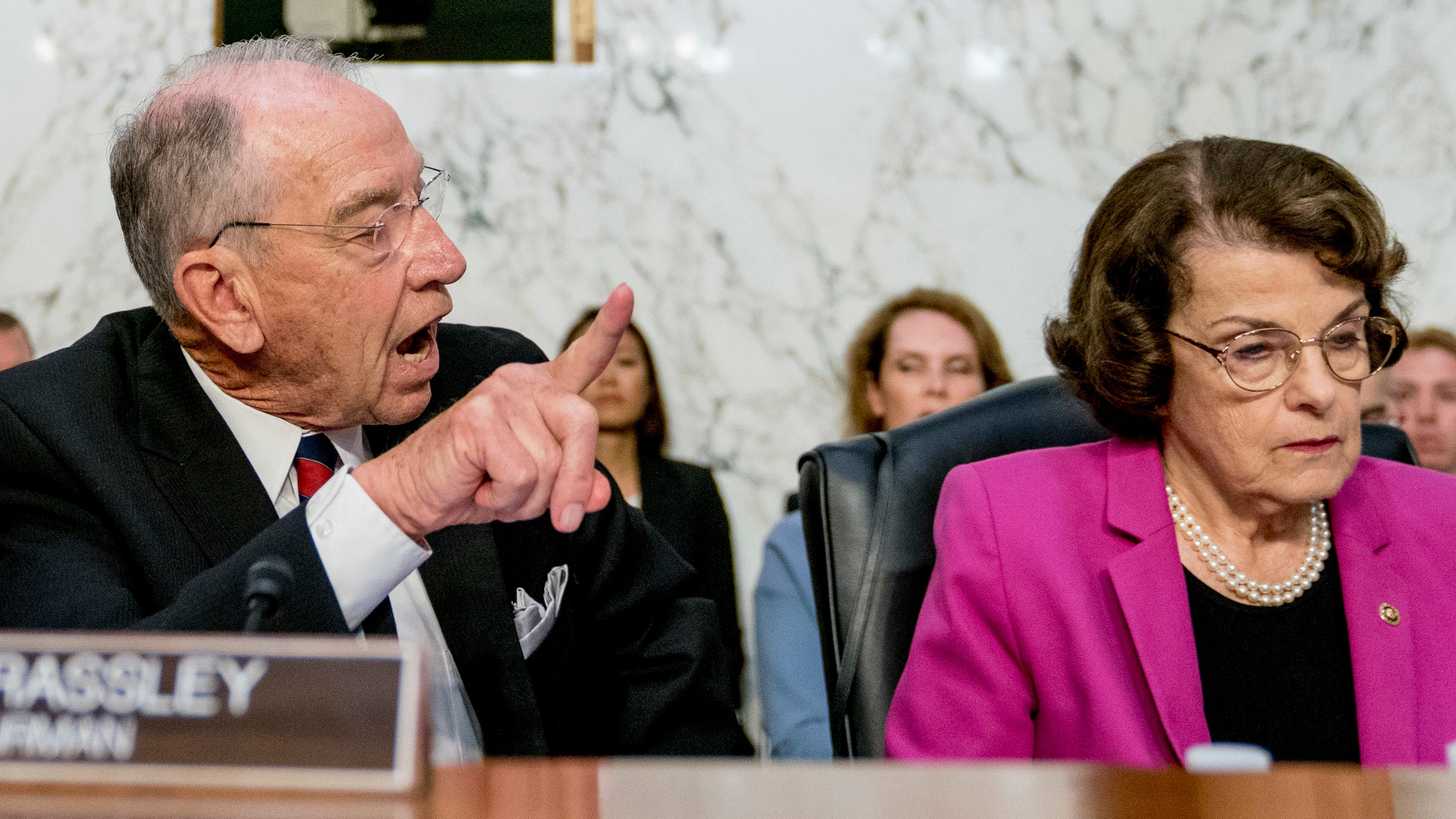 Senate Judiciary Chairman Chuck Grassley, R-Iowa, center, accompanied by Sen. Orrin Hatch, R-Utah, left, and Sen. Dianne Feinstein, D-Calif., the ranking member on the Senate Judiciary Committee, right, speaks toward the committee Democrats as President Donald Trump's Supreme Court nominee, Brett Kavanaugh, a federal appeals court judge, appears before the Senate Judiciary Committee on Capitol Hill in Washington, Tuesday, Sept. 4, 2018, to begin his confirmation to replace retired Justice Anthony Kennedy.