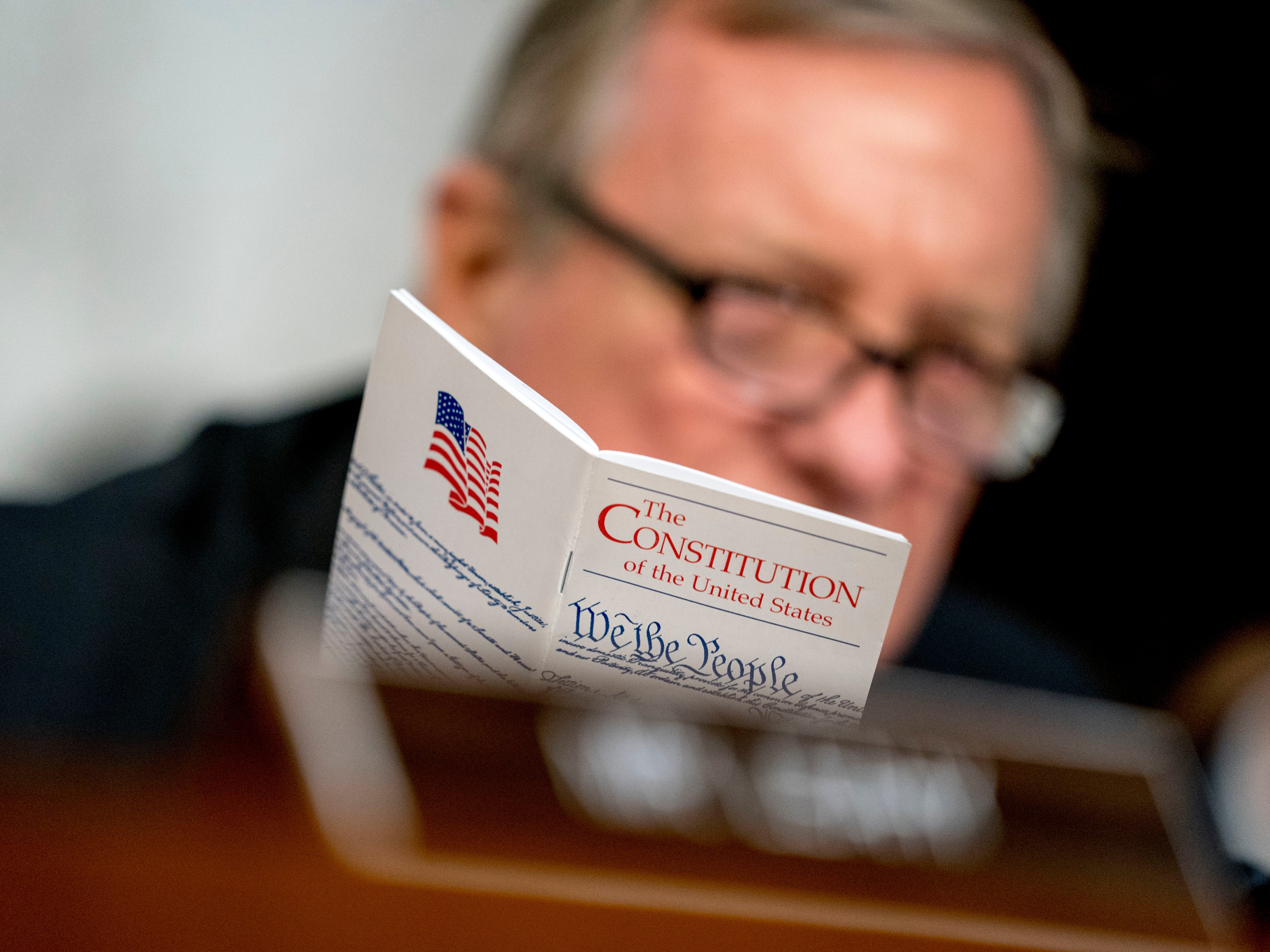 Sen. Dick Durbin, D-Ill. holds up a copy of The Constitution of the United States as he speaks as Supreme Court nominee Brett Kavanaugh, a federal appeals court judge, appears before the Senate Judiciary Committee on Capitol Hill in Washington, Tuesday, Sept. 4, 2018, to begin his confirmation to replace retired Justice Anthony Kennedy. (AP Photo/Andrew Harnik) ORG XMIT: DCAH128