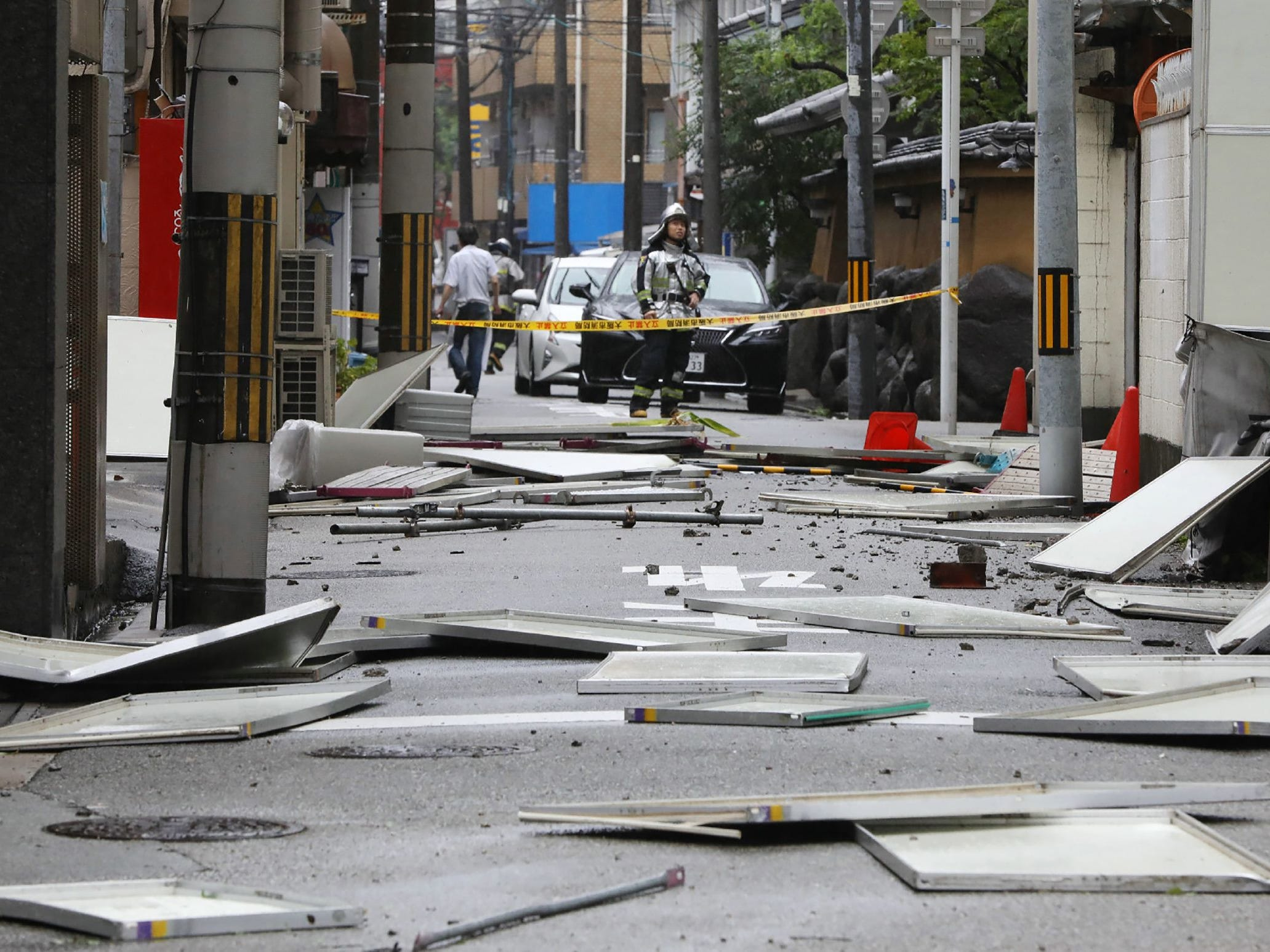 Damage from fallen panels due to weather patterns from Typhoon Jebi are seen on a street in Osaka on September 4, 2018, as the typhoon made landfall around midday in southwestern Japan. - The strongest typhoon to hit Japan in 25 years made landfall on September 4, the country's weather agency said, bringing violent winds and heavy rainfall that prompted evacuation warnings. (Photo by JIJI PRESS / JIJI PRESS / AFP) / Japan OUTJIJI PRESS/AFP/Getty Images ORIG FILE ID: AFP_18U2MU