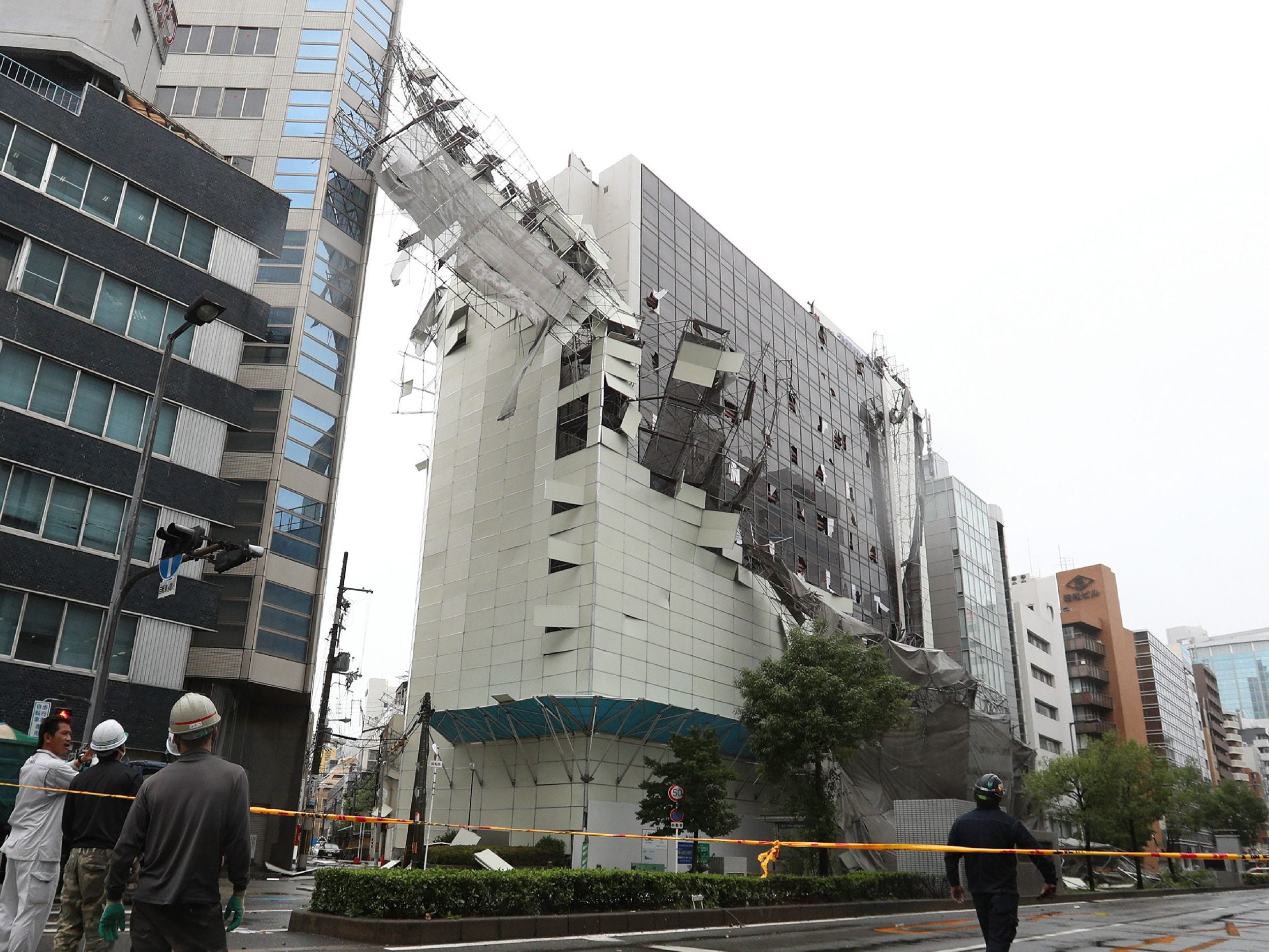 Damage from loose construction scaffolding due to weather patterns from Typhoon Jebi is seen in Osaka on September 4, 2018, as the typhoon made landfall around midday in southwestern Japan. - The strongest typhoon to hit Japan in 25 years made landfall on September 4, the country's weather agency said, bringing violent winds and heavy rainfall that prompted evacuation warnings. (Photo by JIJI PRESS / JIJI PRESS / AFP) / Japan OUTJIJI PRESS/AFP/Getty Images ORIG FILE ID: AFP_18U2M7